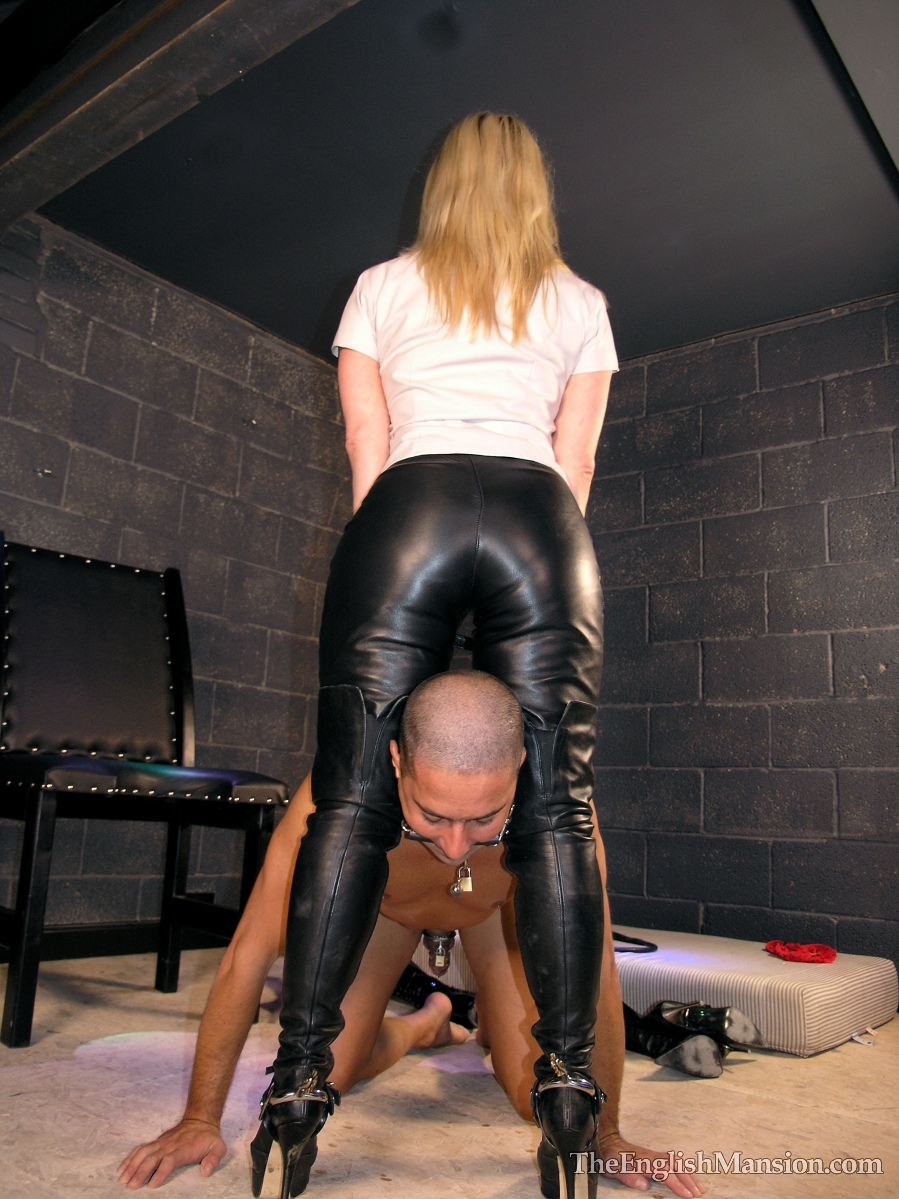 Femdom facesitting and chastity teasing with strapon 7